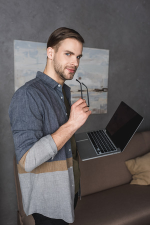 Photo pour young stylish businessman with laptop at modern office - image libre de droit