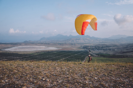 Foto de Parachute in the sky over field in hillside area of Crimea, Ukraine, May 2013 - Imagen libre de derechos