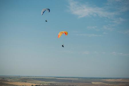 Foto de Parachutes in the sky over field in hillside area of Crimea, Ukraine, May 2013 - Imagen libre de derechos