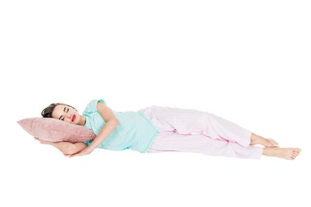 Foto de girl in pajamas sleeping on pillow isolated on white - Imagen libre de derechos