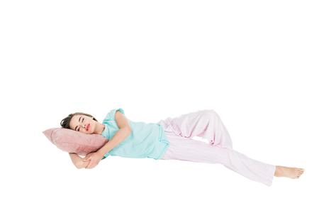 Foto de young woman in pajamas sleeping on pillow isolated on white - Imagen libre de derechos