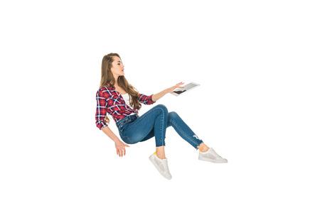 Foto de beautiful girl using digital tablet while levitating isolated on white - Imagen libre de derechos