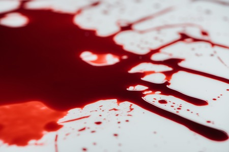 Photo for close-up shot of blood droplets on white surface - Royalty Free Image