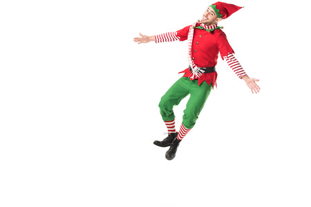 Photo for happy man in christmas elf costume jumping isolated on white background - Royalty Free Image