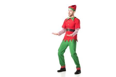 Photo for cheerful man in christmas elf costume outstreching hands in excitement isolated on white - Royalty Free Image
