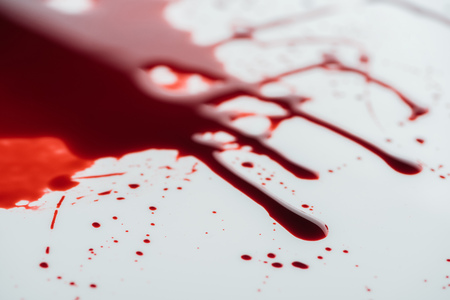 Photo for close-up shot of flowing blood droplets on white surface - Royalty Free Image