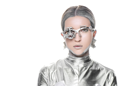 Foto de portrait of silver robot with eye prosthesis looking at camera isolated on white, future technology concept - Imagen libre de derechos