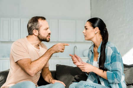 Photo for couple having argument and husband yelling at wife at home - Royalty Free Image