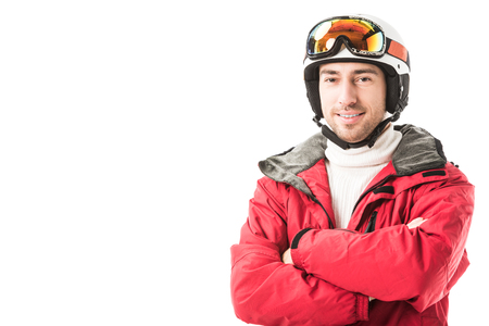 Photo for adult man in red ski jacket, goggles and helmet with arms crossed smiling and looking at camera isolated on white - Royalty Free Image