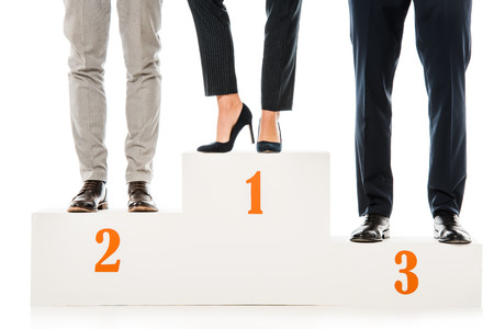 Foto de low section of businesspeople standing on winners podium isolated on white - Imagen libre de derechos