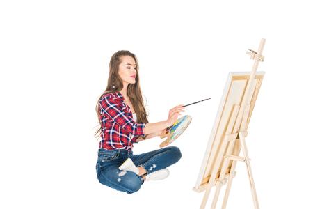 Foto de beautiful young woman painting picture isolated on white - Imagen libre de derechos