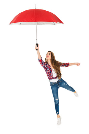 Foto de beautiful young woman holding red umbrella isolated on white - Imagen libre de derechos