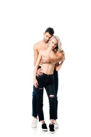 Foto de handsome man holding topless woman in passionate embrace isolated on white - Imagen libre de derechos
