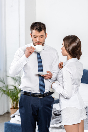 Photo for girlfriend waiting while boyfriend drinking coffee in morning at home, social role concept - Royalty Free Image