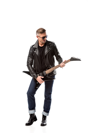 Photo for stylish adult man in leather jacket playing electric guitar isolated on white - Royalty Free Image