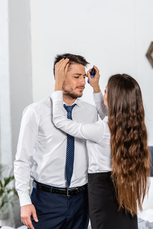 Photo for girlfriend styling boyfriend hair in morning at home, social role concept - Royalty Free Image