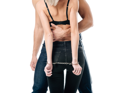 Photo for cropped view of man hugging handcuffed woman in bra from behind isolated on white - Royalty Free Image