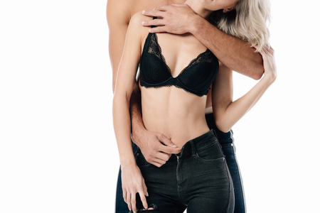 Foto de cropped view of man unzipping jeans of woman isolated on white - Imagen libre de derechos