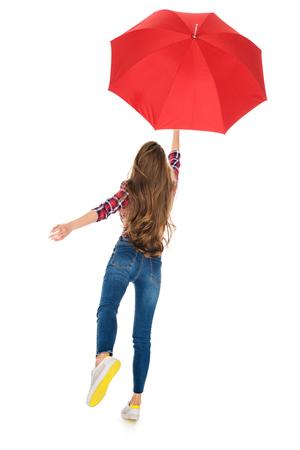 Foto de back view of girl holding red umbrella isolated on white - Imagen libre de derechos