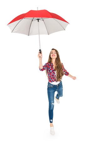 Foto de happy young woman holding red umbrella isolated on white - Imagen libre de derechos
