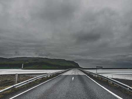 Photo pour road and bridge over the river at cloudy day in Iceland - image libre de droit