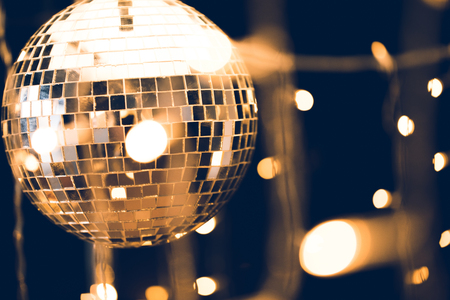 Photo for glossy disco ball with beautiful garland on foreground - Royalty Free Image