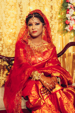 Photo for portrait of beautiful indian woman in traditional clothes looking at camera - Royalty Free Image