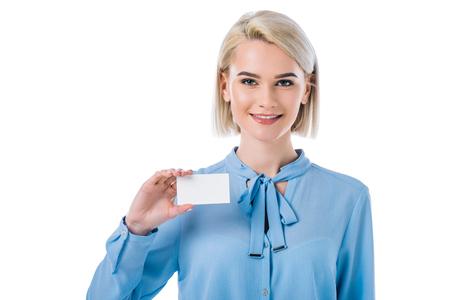 Foto de portrait of smiling woman showing empty card in hand isolated on white - Imagen libre de derechos