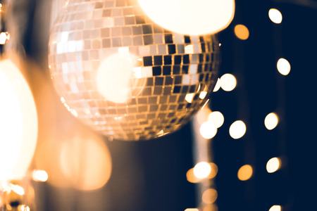 Photo for beautiful disco ball with golden garland on black - Royalty Free Image