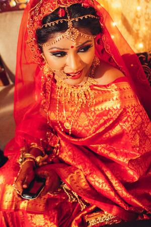 Foto de portrait of beautiful indian woman in traditional clothes looking away - Imagen libre de derechos