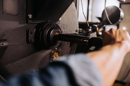 Foto de partial view of coffee roaster working on roasting machine - Imagen libre de derechos