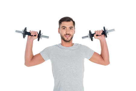 Photo for portrait of sportsman exercising with dumbbells isolated on white - Royalty Free Image