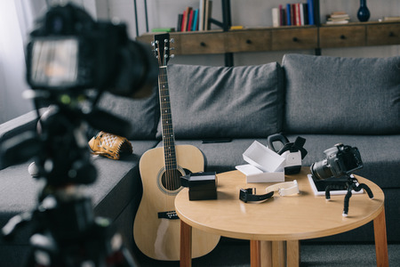 Photo for acoustic guitar and cameras in empty room - Royalty Free Image