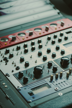 Photo for close-up shot of graphic equalizer with various knobs at recording studio - Royalty Free Image