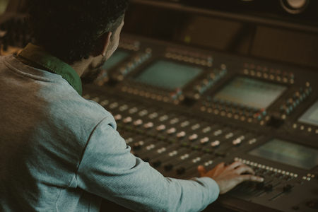 Photo for close-up shot of sound producer working with analog equalizer - Royalty Free Image