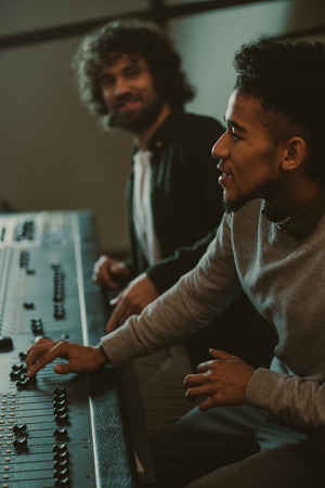 Photo for concentrated young sound producers at recording studio - Royalty Free Image