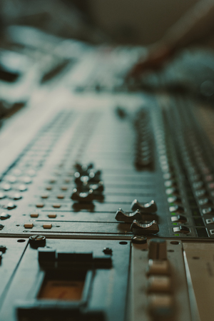 Photo for close-up shot of analog graphic equalizer at recording studio - Royalty Free Image