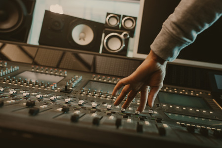 Photo for cropped shot of sound producer setting graphic equalizer at studio - Royalty Free Image