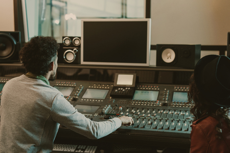 Photo for sound producers looking at blank monitor at recording studio - Royalty Free Image