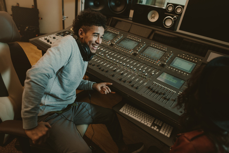 Photo for happy young sound producer sitting at studio - Royalty Free Image