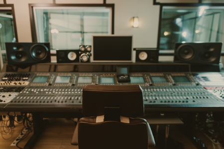Photo for view of sound producing equipment at recording studio with armchair on foreground - Royalty Free Image
