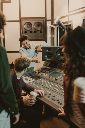 Photo for happy music band spending time at recording studio - Royalty Free Image