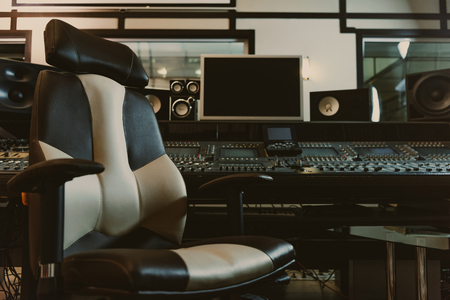 Photo for armchair in front of graphic equalizer at recording studio - Royalty Free Image