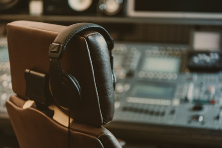 Photo for headphones hanging on armchair at recording studio - Royalty Free Image