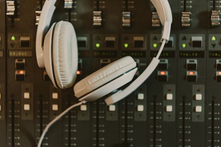 Photo for top view of headphones on graphic equalizer at recording studio - Royalty Free Image