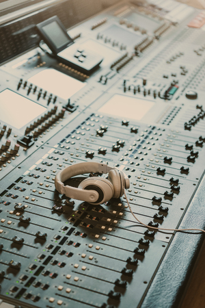 Photo for headphones on graphic equalizer at recording studio - Royalty Free Image