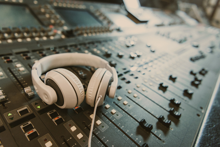 Photo for close-up shot of headphones on graphic equalizer at recording studio - Royalty Free Image