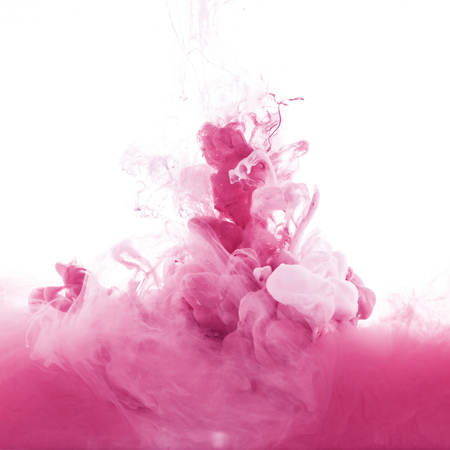 Foto de close up view of pink and light pink paint splashes in water, isolated on white - Imagen libre de derechos