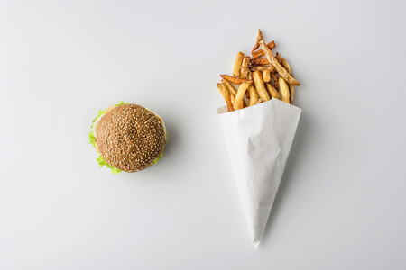 Photo for top view of hamburger and french fries in paper cone, isolated on white - Royalty Free Image