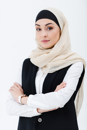 Photo for portrait of muslim businesswoman with arms crossed isolated on grey - Royalty Free Image